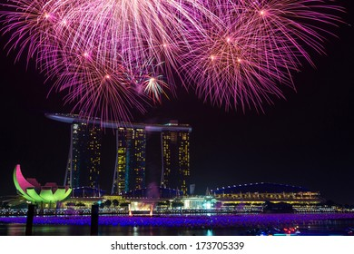 MARINA BAY, SINGAPORE - JAN 01, 2014: New year eve fireworks at Marina Bay Sands Resort Hotel in Singapore. It is billed as the world's most expensive standalone casino property.