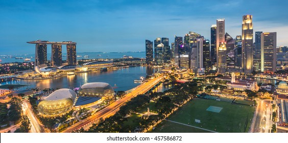 MARINA BAY, SINGAPORE - JULY 16: Singapore skyline from aerial view during twilight time on the July 16,2016 in Singapore