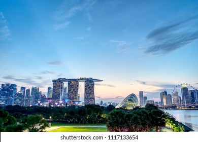 Marina bay, Singapore, Jun 10, 2018: Singapore cityscape seen from Marina barrage in the evening twilight. Singapore is known as tax free, modern city and high living cost in southeast Asia.