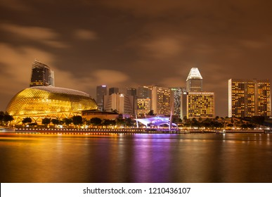 MARINA BAY, SINGAPORE - OCT 6, 2018: Landscape of Singapore business building around Marina bay with shadow reflection. Modern high building in business district area at twilight.