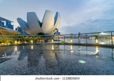 MARINA BAY, SINGAPORE - OCT 7, 2017: Beautiful blue hour with Singapore Art Science Museum as seen from Helix Bridge. The architecture is said to be a form reminiscent of a lotus flower.