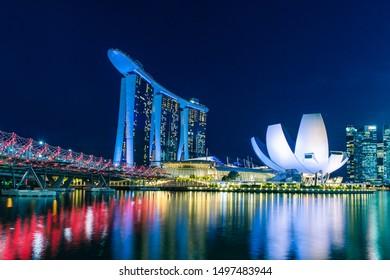 Marina bay,Singapore - 2017 September 21 : Singapore skyline, Singapore Marina bay and helix bridge at dusk, Singapore