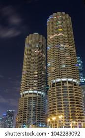 Marina City twin towers illuminated at dusk, North State Street, Chicago, Illinois, October 1, 2016