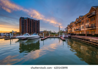 Marina and condominiums at sunset, in Canton, Baltimore, Maryland.