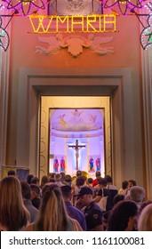 Marina di Gioiosa Ionica, Italy - August 19, 2018: People in a queue waiting to enter in San Nicola di Bari church. Celebration in honor of the Madonna del Carmine.  Marina di Gioiosa, Calabria, Italy
