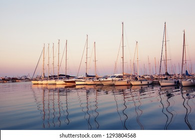 Marina with docked yachts at sunset in Giulianova, Italy