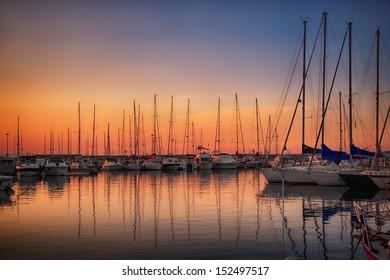 Marina with docked yachts at sunset in Giulianova, Italy