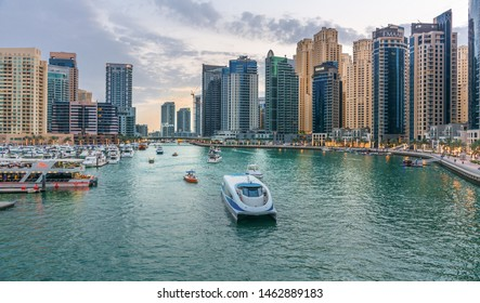 Marina, Dubai/ United Arab Emirates, 4/5/2019, Dubai RTA Boat ferry Service through Marina lake and buildings best Place to enjoy Weekends