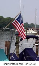 Marina Flag Flying Over Boats