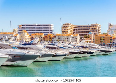 Marina full of luxurious yachts in touristic Vilamoura, Quarteira, Algarve, Portugal