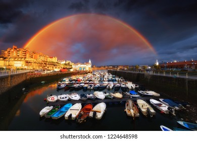 Marina of Getxo with stormy clouds and rainbow
