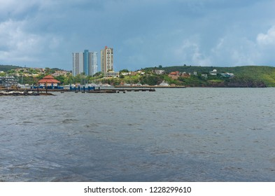marina and high rise buildings surrounded by homes in fajardo puerto rico