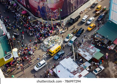 Marina, Lagos Nigeria, December 20 2017: Busy commercial street with refuse dump in the middle of the road causing slow movement of vehicles.
