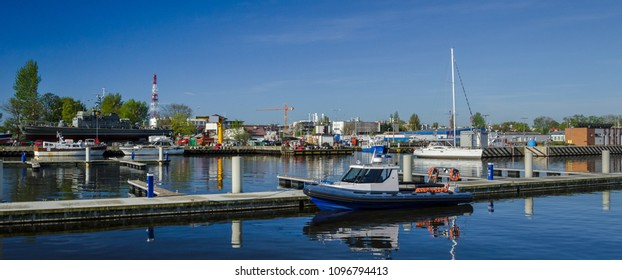 MARINA - Police motorboat and yachts on the port wharf in Kolobrzeg