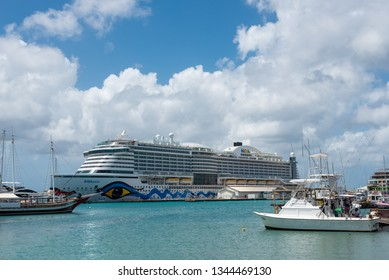 Marina with sports boats in the port of Oranjestad with a cruise in the background. A place surrounded by shops, restaurants and other recreational areas. Oranjestad. Aruba February 23, 2019
