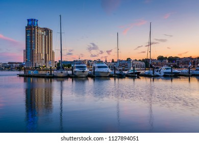 A marina at sunset, at the Inner Harbor in Baltimore, Maryland