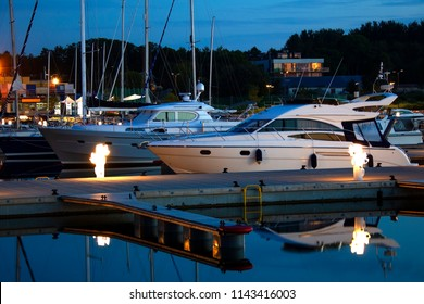 The marina with yachts and fishing boats at night