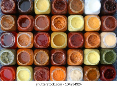 marinades and sauces in bottles, thirty-five pieces, top view with the cover open, isolated