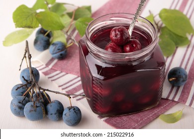 Marinated berries of blackthorn in a square glass jar