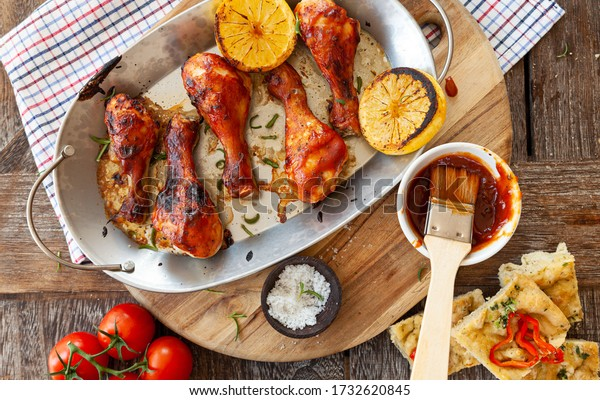 Marinated chicken drumsticks with herbs and lemon