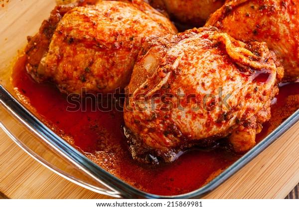Marinated chicken drumsticks. Selective focus