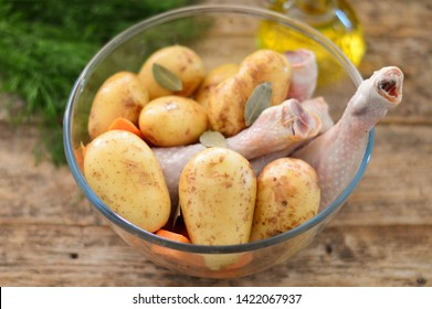 Marinated chicken legs and potatoes