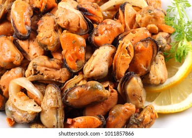 marinated mussels in white plate isolated on white background