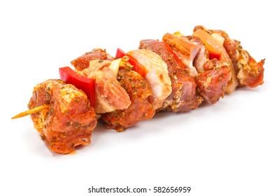 Marinated pork and ham kebab stick on white background