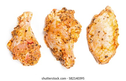 Marinated raw chicken wing parts on white background