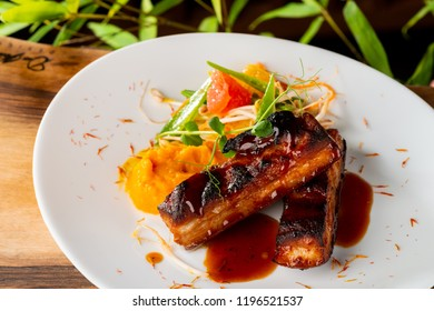 Marinated roasted young Pork Belly in the Honey sauce and mango purree