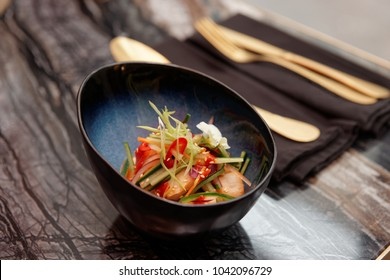 Marinated scallops and raw vegetables in bowl, close-up, Asian style hot dish