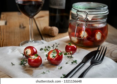 Marinated small red peppers stuffed goat cheese with glass of wine