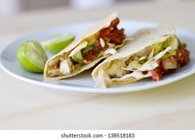 Marinated striped bass tacos with cabbage slaw, and fresh salsa.