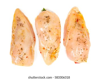 Marinated and stuffed chicken breast fillet on white background