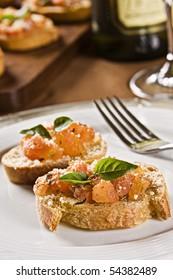 Marinated Tomato Bruschetta with Basil and Grated Cheese. Studio Photography.