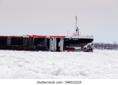 MARINE CITY, MI, USA /JANUARY 17, 2015: The ST CLAIR of the American Steamship Company is down bound on the icy St Clair River at Marine City, MI on January 17, 2015.
