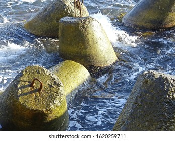 Marine concrete breakwaters (anchors) in shallow water. Traveling-wave protection, concrete breakwater