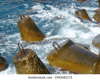Marine concrete breakwaters (anchors) in shallow water. Traveling-wave protection, concrete breakwater - Shutterstock ID 1943585173