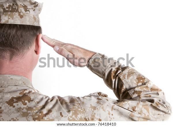 Marine In Desert Fatigues Saluting
