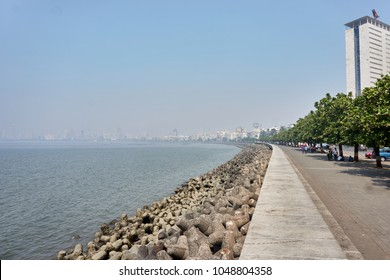 Marine drive or necklace,The road links Nariman Point to Babulnath and Malabar Hill. A promenade lies parallel to this road. Back Bay is part of the Arabian Sea. Mumbai India Asia.  smog smoke