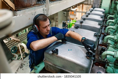 Marine engineer officer reparing vessel engines and propulsion in engine control room ECR. Ship onboard maintenance - Shutterstock ID 1835041105
