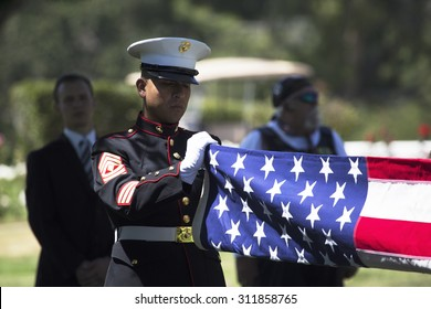 "Marine folds flag at Memorial Service for fallen US Soldier, PFC Zach Suarez, ""Honor Mission"" on Highway 23, drive to Memorial Service, Westlake Village, California, USA, 06.19.2014"