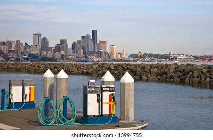 Marine fuel pumps at marina, city skyline in the distance