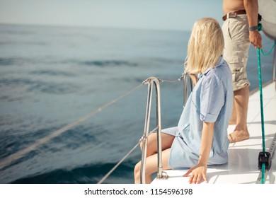 Marine holiday on sailing yacht. Joyful caucasian couple on pleasure yacht. Living a happy life. Romantic vacation concept.