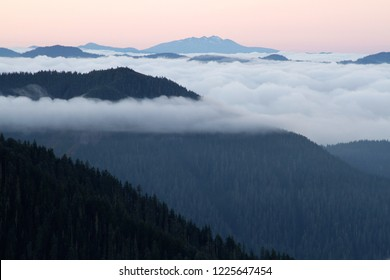 Marine layer looking over H. J. Andrews forest, Lookout Mtn, and the Three Sisters Wilderness, with Diamond Peak in background, from Carpenter Mountain fire lookout
