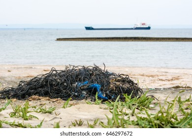 Marine litter, nets washed up on beach shore