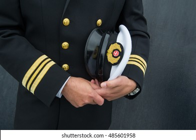 marine sailor holding his hat