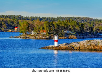 Marine signs and lighthouse in the Stockholm archipelago rocky island to help you navigate in shallow water