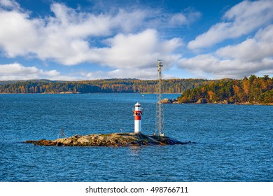 Marine signs and lighthouse in the Turku archipelago rocky island to help you navigate in shallow water