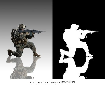 Marine soldier. Studio shooting. With alpha channel. Sitting pose. with reflections. isolated.